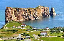 Percé (2006 Population 3,419) is a small village near the tip of the Gaspé Peninsula in Québec. It has a long history of being an important seasonal fishing centre under the French. Today the area is mainly a tourist location particularly well-known for the attractions of Percé Rock and Bonaventure Island. Percé Rock is a natural rock formation located close to the shore facing the town. It is a natural tourist attraction for its size, color, and unusual door-like hole at one end the rock.